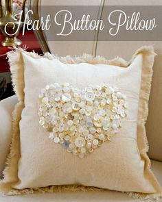 Painters drop cloth and thrift store buttons were all I needed to make this button heart pillow. I love the vintage touch that the various shades of buttons giv…