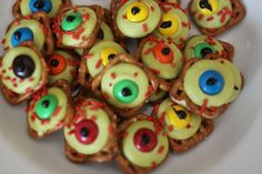 Zombie Eyeballs - Halloween Treat  - Pretzels, M&M's, Red Sprinkles, Lime Green Candy Melts, & Black Icing