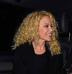 """Kylie recently let her hair go completely natural, which falls into the """"afro style"""" that currently trending according to hairstylist and global stylist of Nexxus, Kevin Mancuso, who adds that these type are curls are more """"gravity defined."""" To embrace this look, style with Nexxus Oil Infinite Nourishing Hair Oil."""