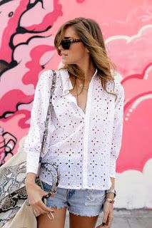 White blouse and jeans shorts .