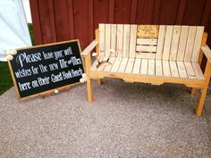 This couple chose a very unique way for their guests to leave a message.  Instead of the traditional guest book, they used a custom bench  from etsy with a custom chalkboard sign by Grand Illusions.