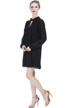 Keyhole Tunic Dress w/Button Collar ($62) A Little Black Dress to wear to all those work events and functions that you want to look chic, modest, and fierce. Features a keyhole at the neck with button collar, sheer sleeves, and an elegantly simple silhouette. Pair with delicate gemstones and colored heels for your next date night.