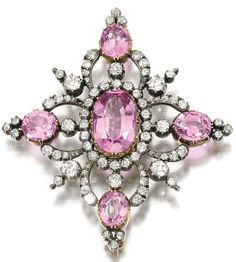TOPAZ AND DIAMOND BROOCH, LATE 19TH CENTURY Set with oval pink topazes, circular-cut and rose diamonds.