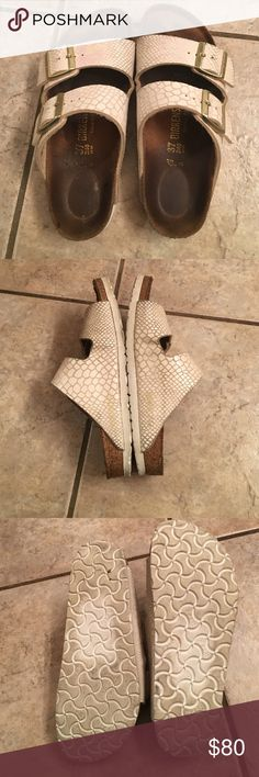 BirkenstockFLASH SALE White shiny Snake skin style used for about a month and for the most part worn at home. Make an offer Birkenstock Shoes Sandals