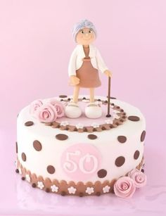 Prettily presented 50th birthday cake idea in pink and brown with Grandma on top. See more 50th birthday cakes and party ideas at www.one-stop-party-ideas.com
