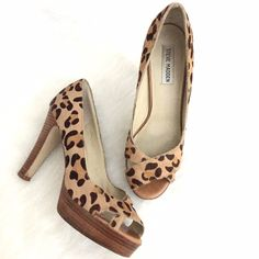 "BANANA SALE Leopard Print Calf Hair Pumps So chic and the perfect wardrobe staple. Excellent pre worn condition. Stunning Steve Madden leopard calf hair peep toe pump with wood platform and heel. 4.5"" heel. No Trades. TB1037. Steve Madden Shoes Heels"