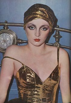 Givenchy cobra turban and bra top, photographed by David Bailey for the November 1973 issue of Vogue UK.