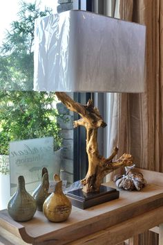 Elegant gold coated driftwood lamp. A work of art and beautiful on its own. We love.