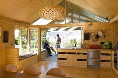 Captivating Wooden House for Rural Living Space: Wide Kitchen And Dining Area In The Shoal Bay Bach With Wooden Counter And Wooden Floor