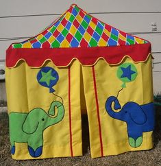 DIY Table Playhouse — Wendy from Old Days – Old Ways made this colorful circus tent. She includes great instructions for several variations. #tableplayhouse #brightideas #tablelinenhacks