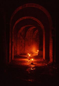 Paris catacombs, the remains of more than 6 million people repacked into perfect rows and patterns, just imagining what it must have been like to do that was amazing, and then the French Resistance hid here, how creepy must that have been? Arte Obscura, Red Aesthetic, Dark Art, Fantasy Art, Creepy, Scenery, Photography, Aesthetics, French Resistance