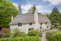 This idyllic 16th century fairy tale thatched cottage in Devon is up for sale