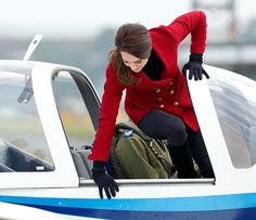 Catherine Duchess of Cambridge climbs out of the cockpit of a Grob 115E 'Tutor' aeroplane during a visit to RAF Wittering to meet air cadets taking...