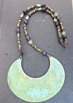 Patina green metal pendant, Amethyst gemstone, wood, Czech glass and brass metal necklace. Bohemian jewelry.