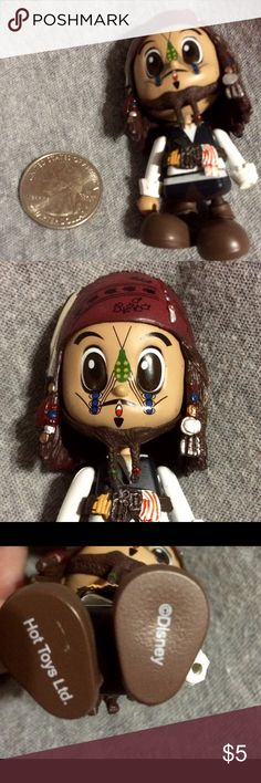 Jack Sparrow Figure Johnny Depp In good condition . His hand is missing . Sized next to a quarter . Accessories
