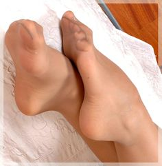 I told her I was really turned on by the sight of a woman's feet in sheer pantyhose. So, she let me take this photo