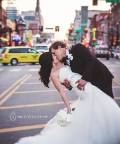 Downtown Nashville wedding photo...OMG they are on Broadway downtown!!!! I see a ton of these pics when I'm down there!!!! I want that pic someday!!!!