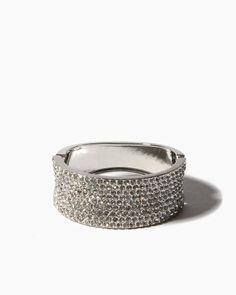 Multiply the dazzle in a softly curving hinged bracelet decorated with not one, not two, but nine stunning rows of sparkling rhinestones.