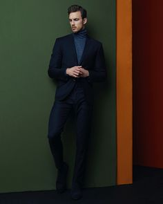 Christian wears suit Acne Studios, turtleneck Thom Browne, and shoes Paul Smith.