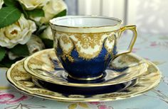 Crown Staffordshire Blue and Gold Teacup Trio
