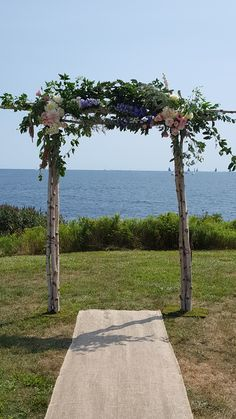 The ocean and this lovely wedding chuppah set the backdrop for a ceremony at Beavertail Park.
