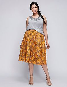 A floral lace (of the subtle sheen and lily variety) lays over the striped full skirt. 6TH & LANE proves that pattern mixing definitely pays off. Elastic waist. lanebryant.com