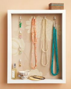Some baubles are just too pretty to put away at the end of the day. But with a jewelry holder and display case made from a basic shadow box, you'll have less clutter, more chances to admire your favorite pieces, and everything within reach.