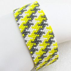 I took my popular two-color houndstooth cuff and tweaked it a little: houndstooth in three colors, including an eye-popping gorgeous yellow! Inspiration comes from the coolest places, doesnt it? One of my favorite things to do is to take a design from one medium and translate it into
