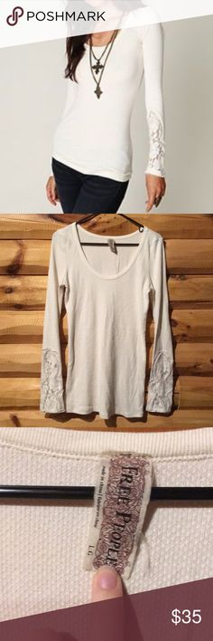 Free People! Cream thermal lace sleeve top size L! Excellent condition! No rips or stains! Beautiful warm long sleeve Tunic top! Check out my other listings! Bundle and save:) Free People Tops Tunics
