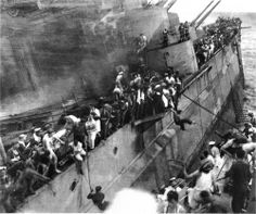The crew of HMS Repulse leaving the ship before it sinks after a Japanese air attack.
