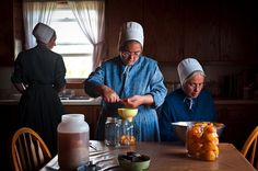 These three Amish ladies are canning fresh peaches.  How wonderful they will taste when all the snow is on the ground. ~ Amish Home Inside ~ Sarah's Country Kitchen ~