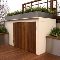 Storage with green roof on roof terrace