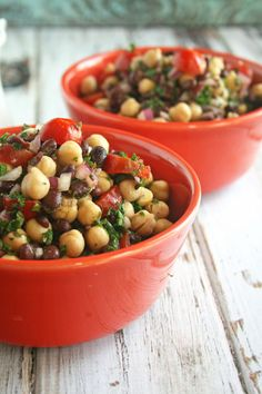 Black bean and chickpea salad! Ingredients include black beans chickpeas parsley olive oil apple cider vinegar garlic onion salt and pepper.
