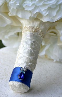 Handle decor with wedding dress lace and a crystal