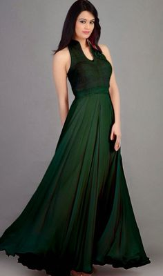 Transform your ordinary day into a fairy tale ending draped in this bottle green velvet and georgette gown. The desirable fancy embellishments work a significant element of this gown. #EveningWearGownDesign
