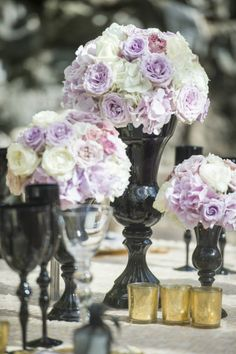 The Hottest New Wedding Reception Ideas You Will Love - Black Vases, White & Purple flowers, Gold accents with candle holders