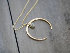 Hey, I found this really awesome Etsy listing at https://www.etsy.com/listing/544523130/druzy-moon-necklace-gold-horn-crescent