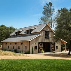 Commercial Barn Great Plains Western Horse Barn project by Sand Creek Post & Beam. View this gallery for ideas on your next dream barn. Horse Barn Plans, Pole Barn House Plans, Barn Garage, Pole Barn Homes, Pole Barn Kits, Metal Pole Barns, Pole House, Garage Doors, Metal Building Homes
