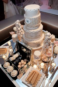 This elegant display incorporates a gorgeous wedding cake along with other small dessert creations.