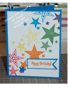 All products are Stampin' Up! 4 1/4 x 5 1/2 inch card base in Pacific Point 4 x 5 1/4 inch layer in Whisper White stamp sets Simply Stars and Pendant Parade colors: Real Red, Pumpkin Pie, Daffodil Delight, Garden Green, Pacific Point, and Elegant Eggplant