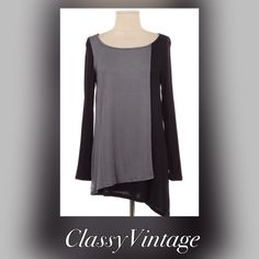 Two tone black and grey tunic Black tunic with a grey fold over front.made in USA - runs true to size. This is a size Medium. Luxurious 95% Rayon and 5 % spandex. Bust 38. The Pink Tops Tunics