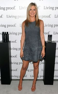 Jennifer Aniston wearing Rolex Day Date Presidential Wristwatch with Champagne Stick Dial, Balenciaga Suede Flared Dress,
