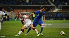 Johannes Geis of Germany is challenged by Lorenzo Crisetig of Italy during a U21 International...