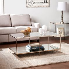 Elevate the look of your living space with this elegant coffee table. Designed with a tempered glass top, this dazzling table features a mirrored lower shelf and a gold tone finish. This lovely table