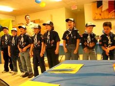 """We are the Cub Scouts"" Love it!! I would love to know how they got them all to do it!!"