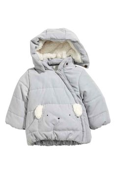 Padded jacket: Padded jacket in woven fabric with a soft, brushed finish with a detachable, pile-lined hood, diagonal zip at the front, and a kangaroo pocket with a print motif and pile appliqués. Elastication at the cuffs and hem and fleece lining front and back.
