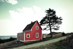 That red house from the tourism video, Newfoundland. Photo by my friend Charlotte Morgan. Red Houses, Atlantic Canada, Clotheslines, Newfoundland And Labrador, Prince Edward Island, New Brunswick, Salt And Water, Nova Scotia, Roots