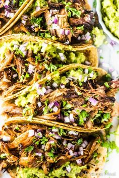 SAVE FOR LATER! Carnitas Tacos (pulled pork tacos) are THE BEST ever! The slow cooker Mexican pork is unbelievably tender and flavorful. Add a scoop of guacamole to a tortilla (or lettuce wrap!), top with a big pile of pulled pork and dig in! Pulled Pork Wrap, Mexican Pulled Pork, Pulled Pork Tacos, Pulled Pork Recipes, Mexican Pork Tacos, Pulled Pork Quesadilla, Shredded Pork Tacos, Shredded Pork Recipes, Quesadillas