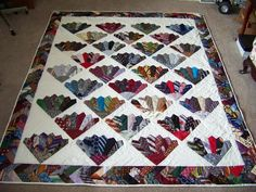 Unique way to use Men's ties in a quilt.  Would be a great idea for a Memory quilt.