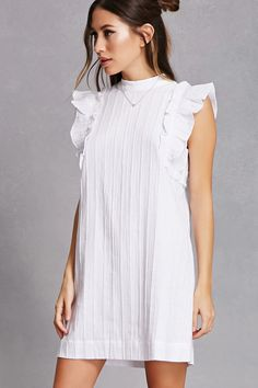 A woven mini dress featuring a mock neck, panel seam design, ruffle cap sleeves, and a button back keyhole.<p>- This is an independent brand and not a Forever 21 branded item.</p>